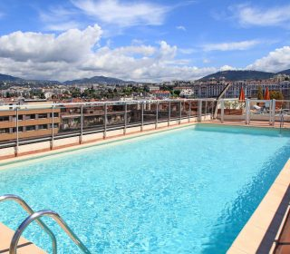 swimming pool on the roof of resort with urban view, Nice, France